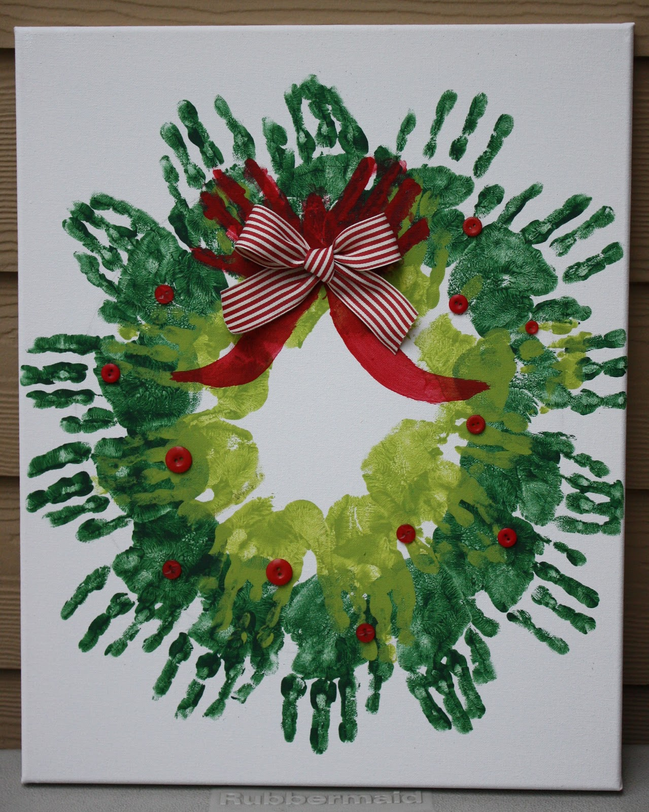 Homemade holiday gifts baby wobbler handprint wreath for Christmas craft ideas for 6 year olds